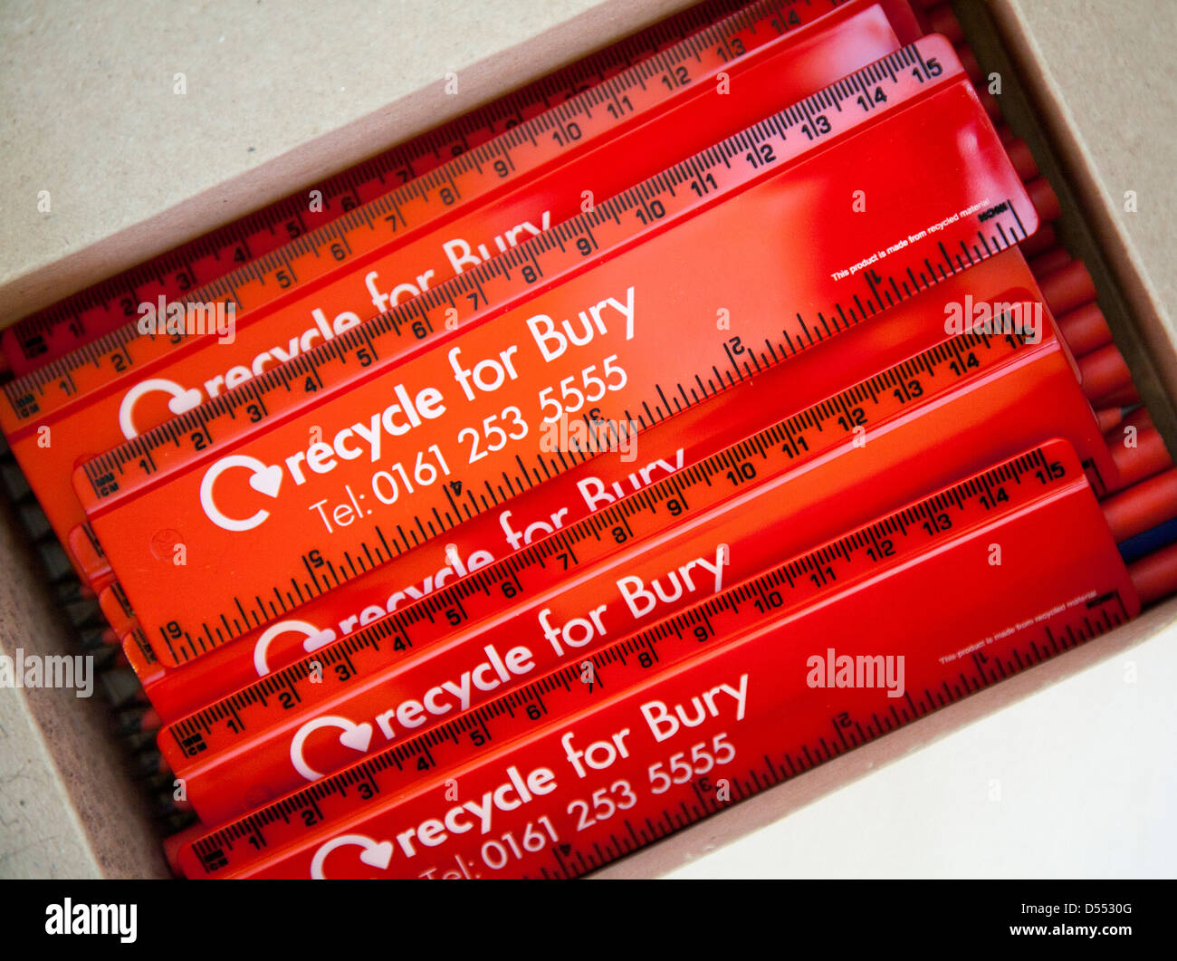 'Recycle for Bury'_Red Recycled 6inch/150mm flat ruler made from reused UK waste, CD cases and by recycling - Stock Image