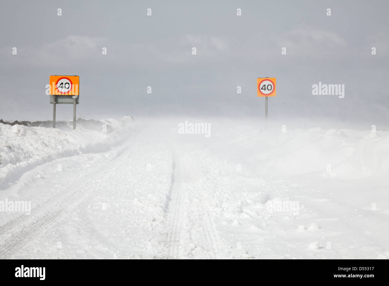 Country road blocked by drifting snow in Yorkshire UK - Stock Image