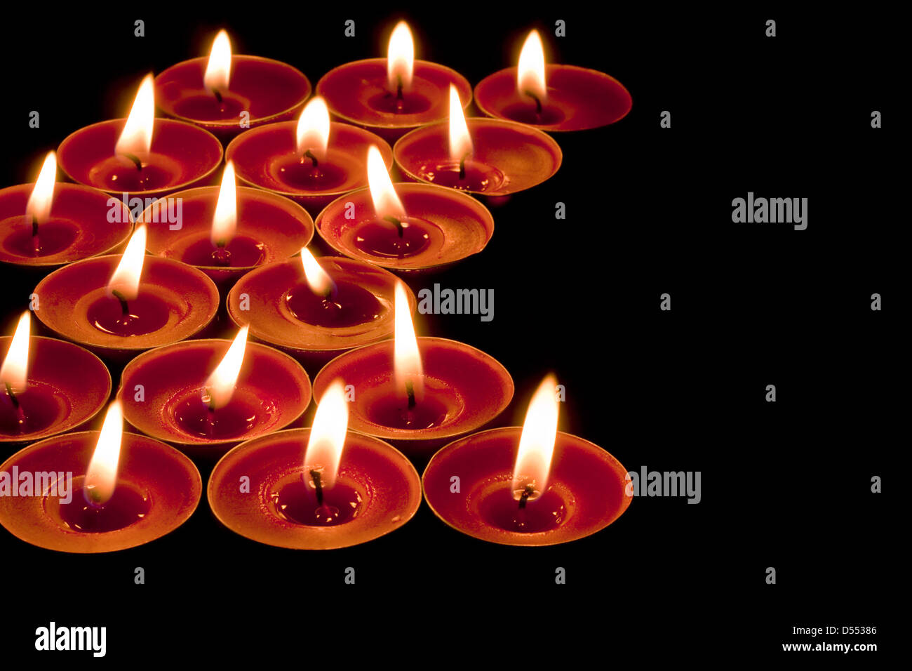red candlelight edging or border on a black background - Stock Image