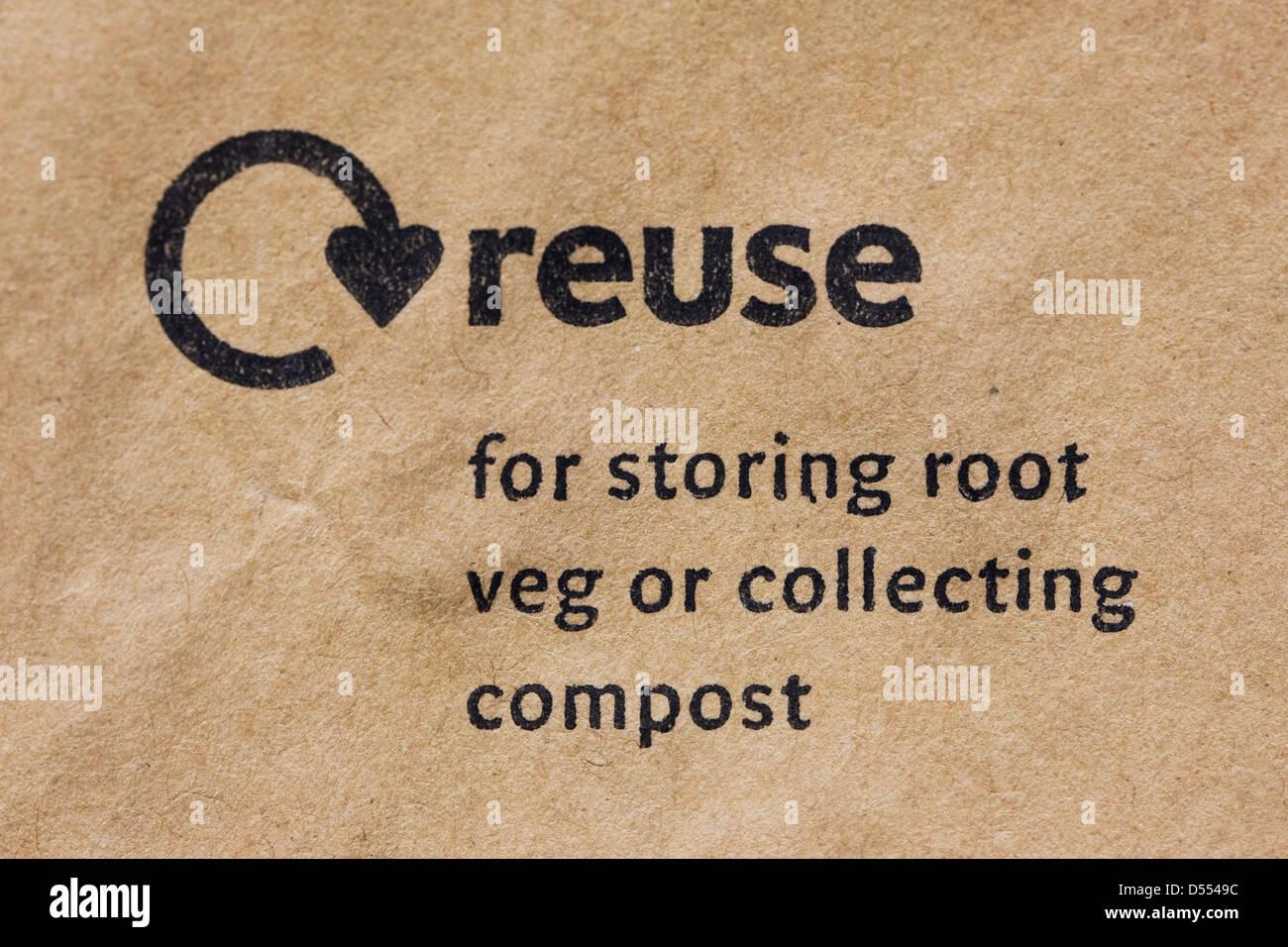Reuse logo on a brown paper bag. - Stock Image