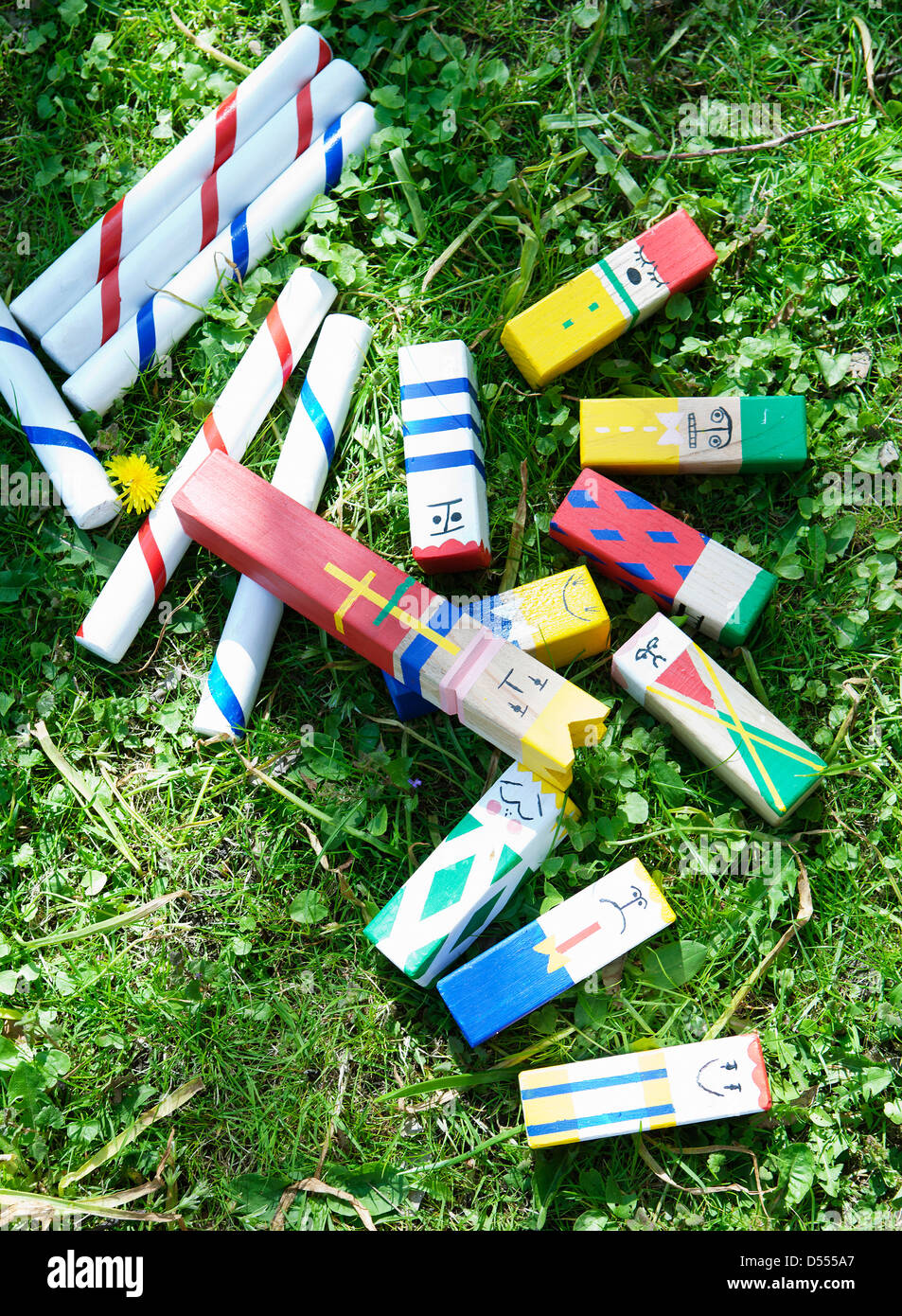 Homemade toys in grass - Stock Image