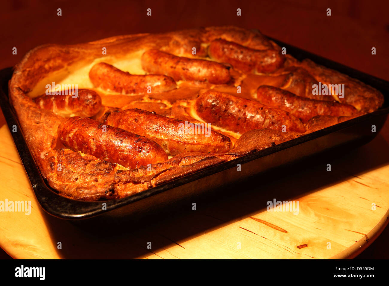 A tray of the classic British dish Toad in the Hole. - Stock Image