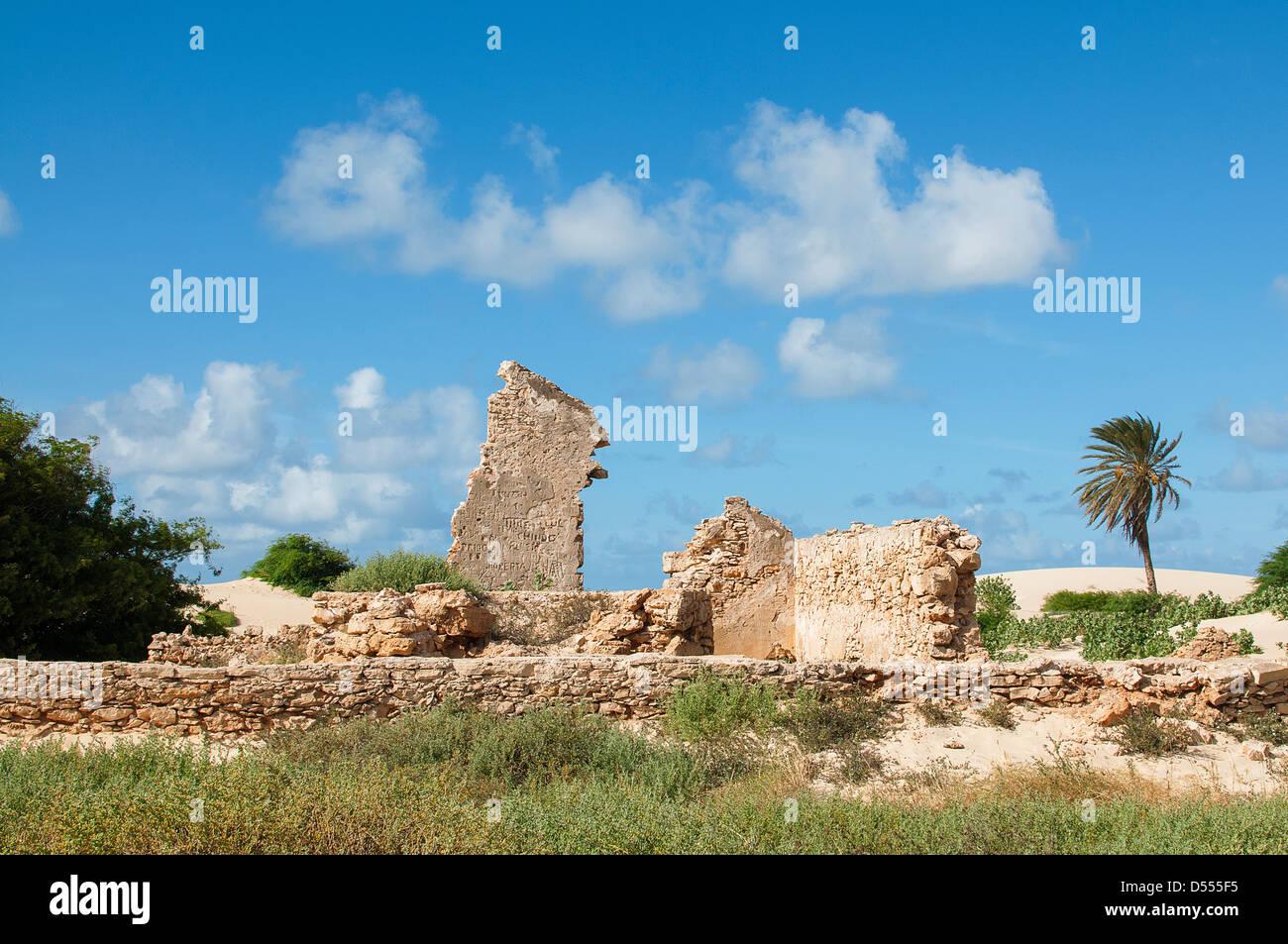 Stone ruins under blue sky - Stock Image
