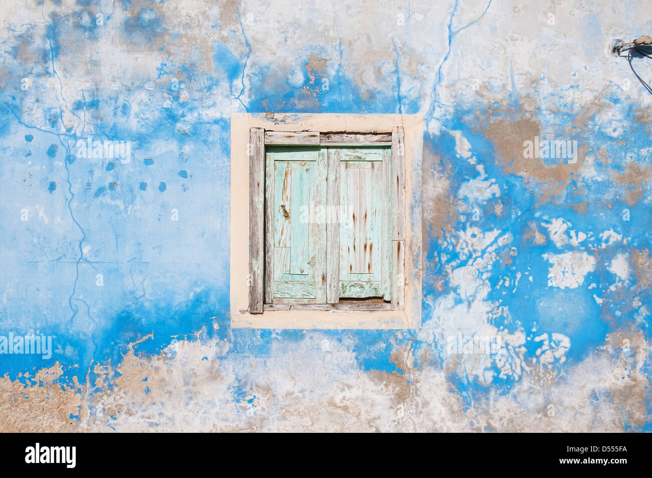 Dilapidated window, shutters and wall - Stock Image