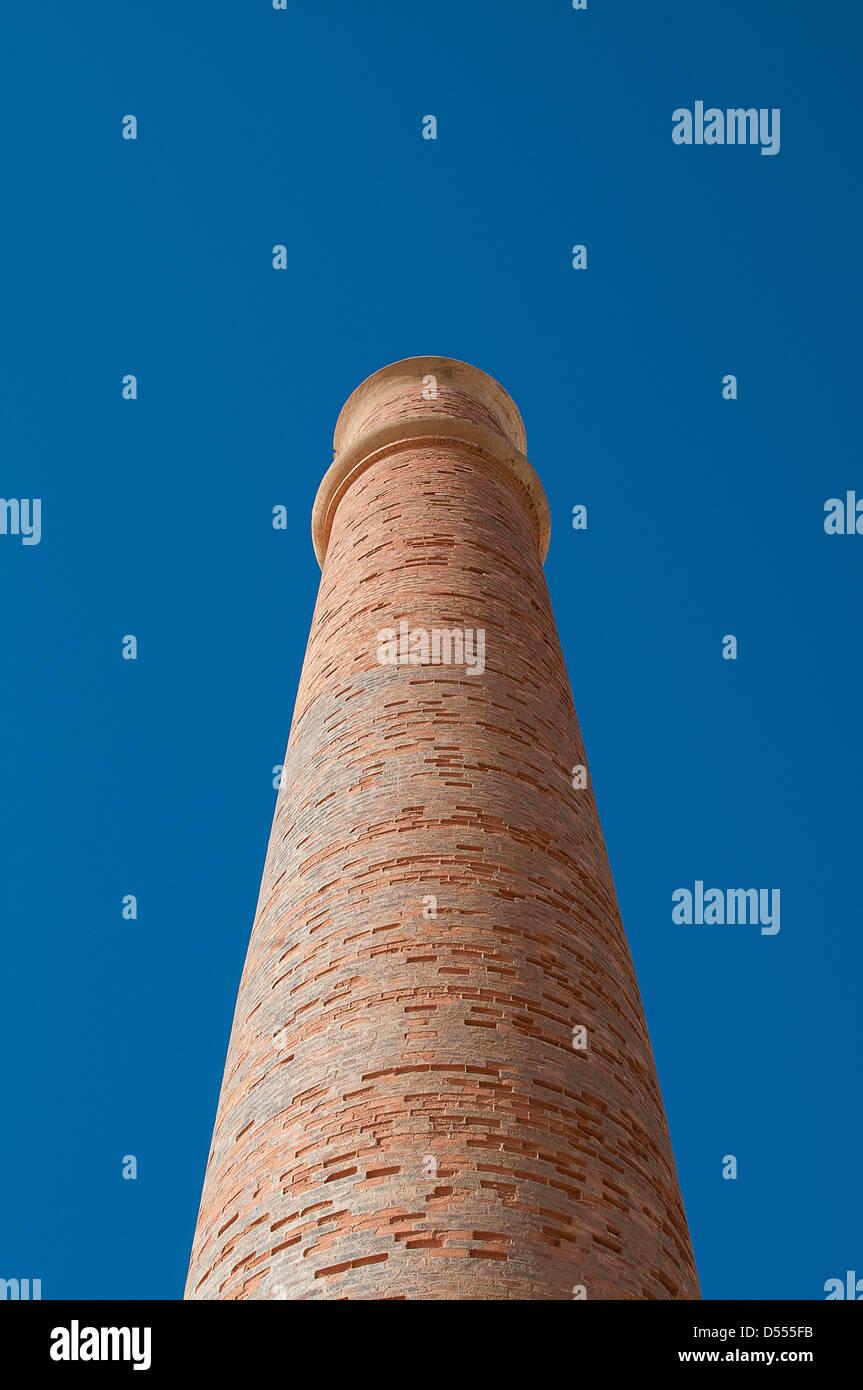 Low angle view of smokestack - Stock Image
