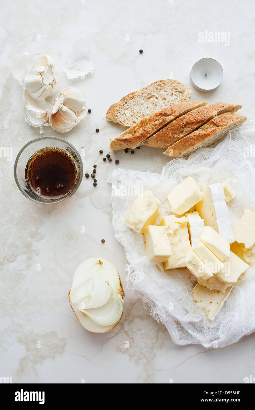 Sliced bread, butter and garlic - Stock Image