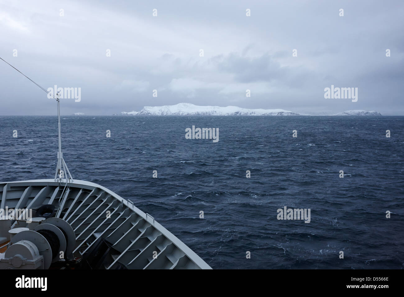 on board hurtigruten passenger ship sailing through fjords during winter norway europe - Stock Image