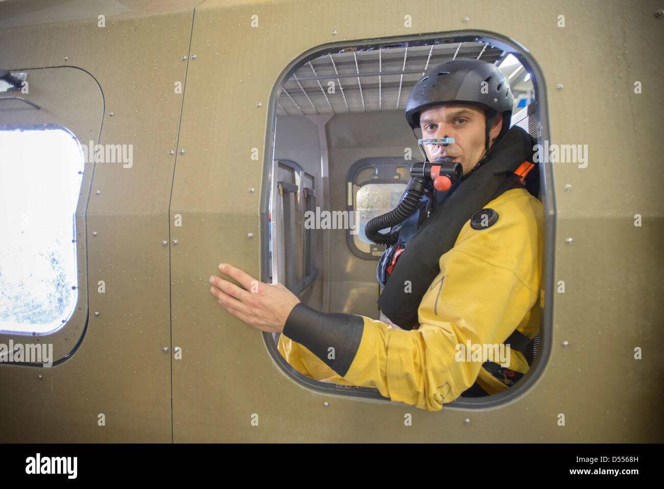 Oil worker in simulated helicopter - Stock Image