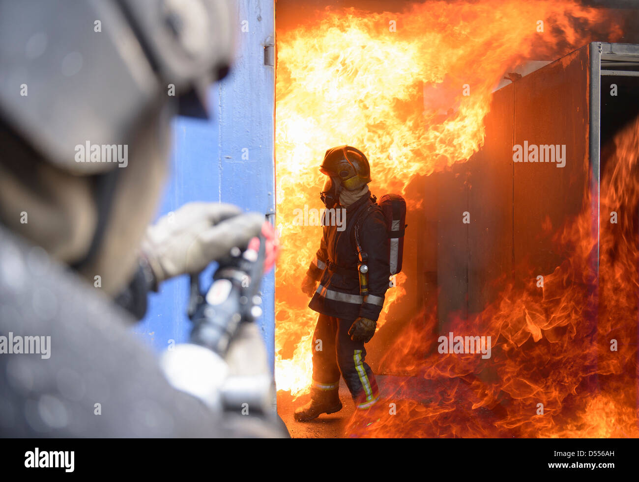 Firefighters in simulation training Stock Photo