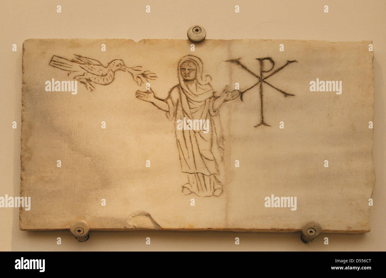 Early Christians. Roman tombstone. Woman with a Chi Rho and a dove with olive branch. Baths of Diocletian. Roman. - Stock Image