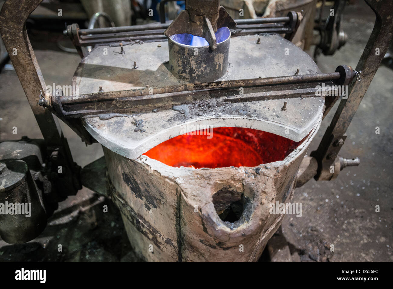 Heated metal flask in foundry - Stock Image