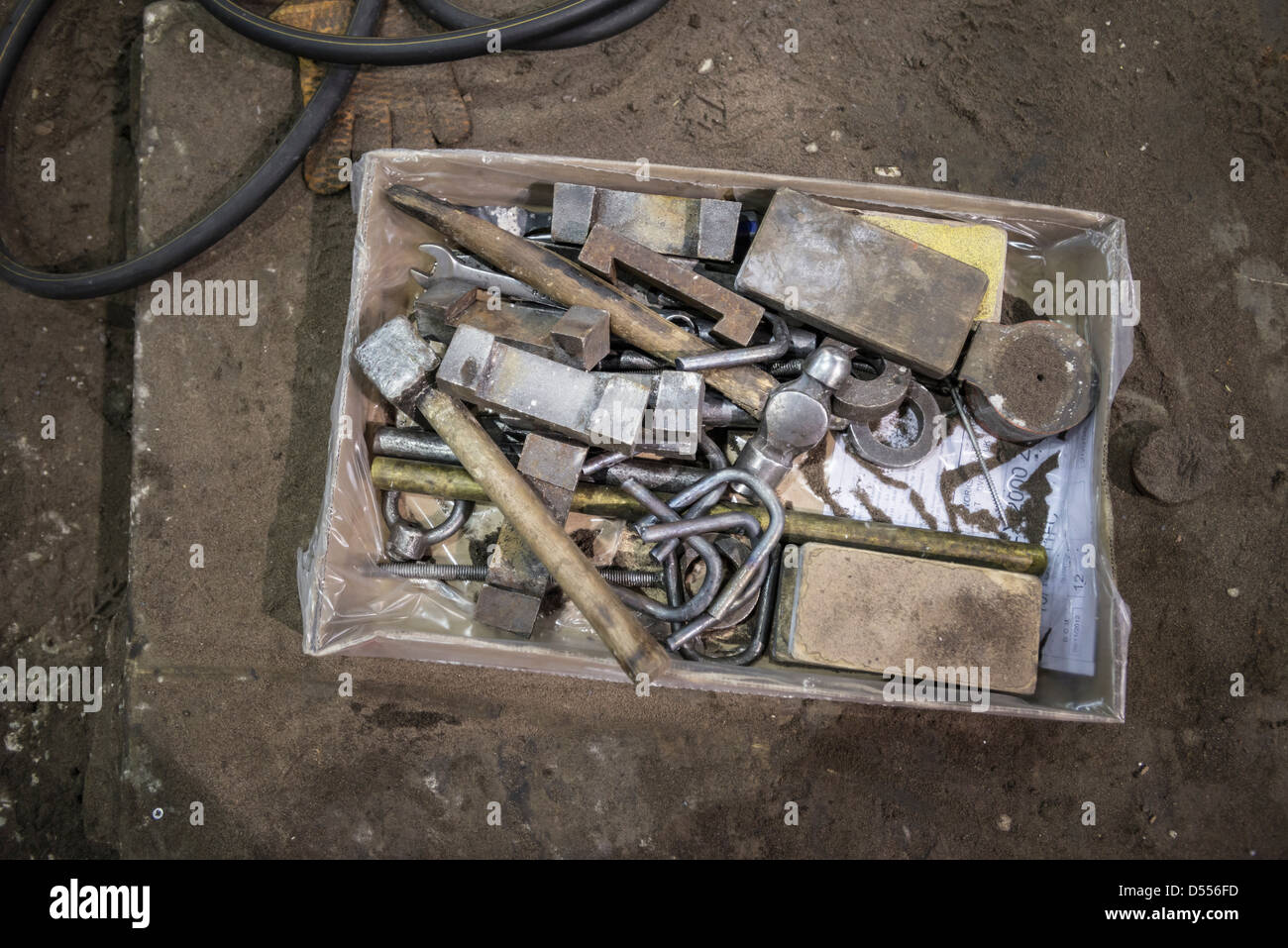 Box of tools in metal foundry - Stock Image