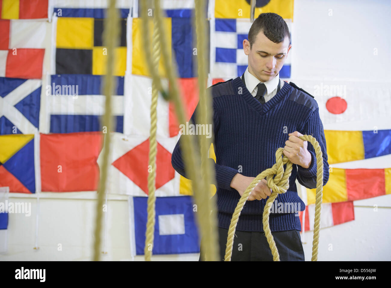Nautical student learning to splice rope - Stock Image