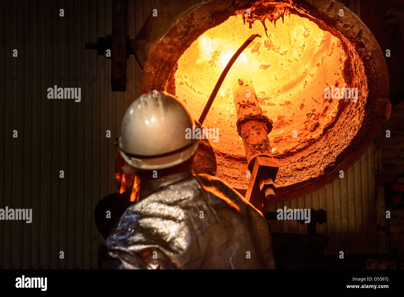 Workers cleaning metal flask in factory - Stock Image