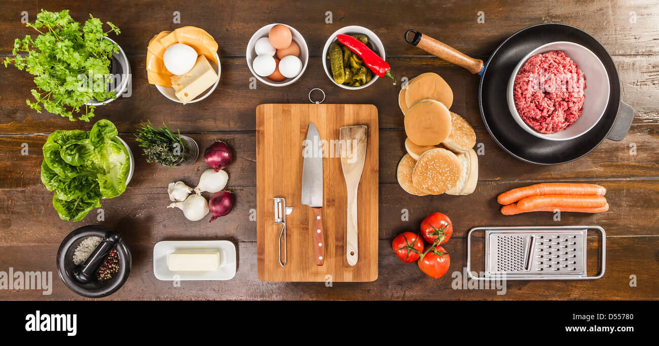 Table laid with ingredients and utensils - Stock Image