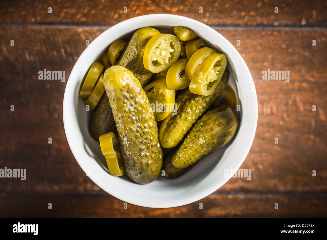 Bowl of pickles and chili pepper slices - Stock Image