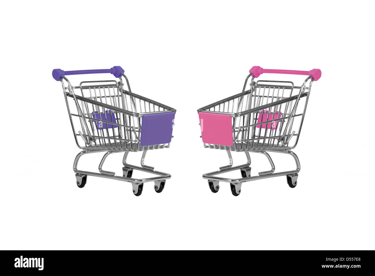 Two shopping carts observing isolated over white - Stock Image