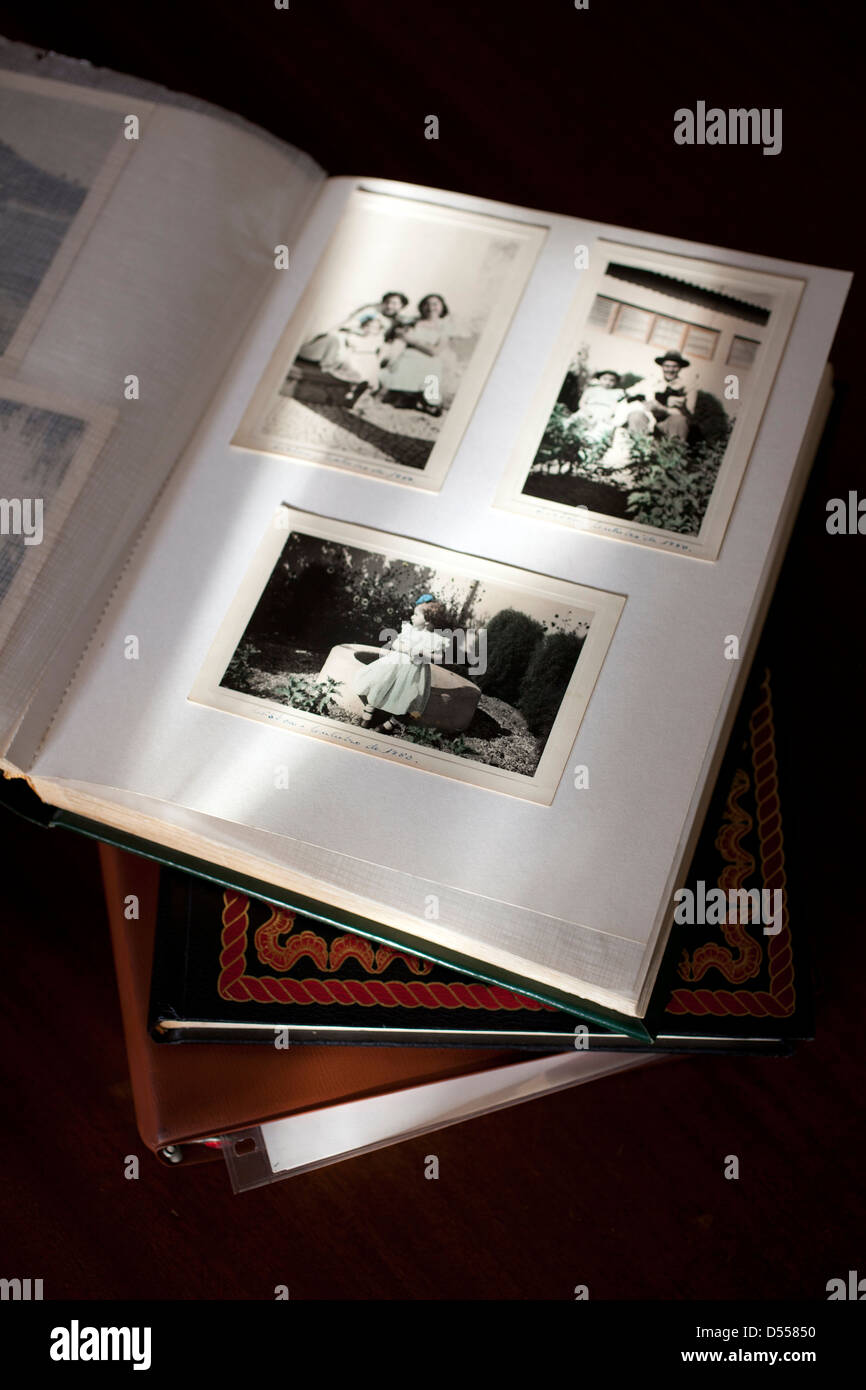 Old photographs in album. - Stock Image