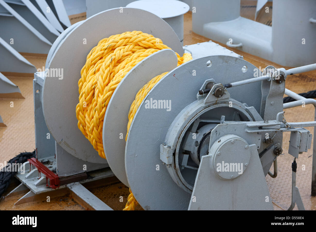 ships tying up ropes on reel on bow of ship - Stock Image