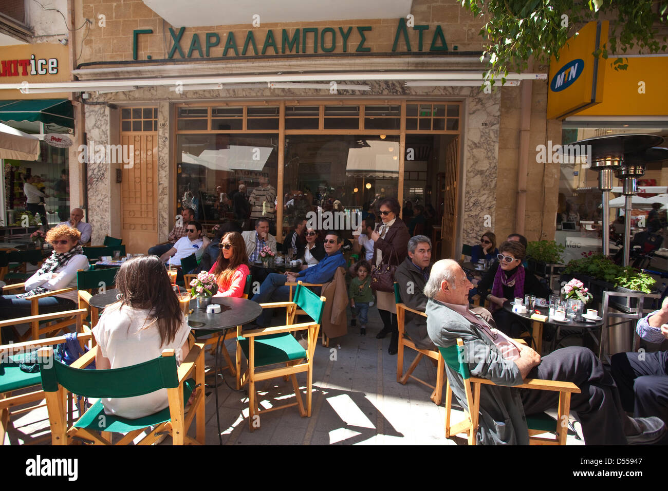 Lidras Street, Nicosia, Cyprus. 25th March, 2013.  Cypriots sitting drinking coffee on the streets of Nicosia, after - Stock Image