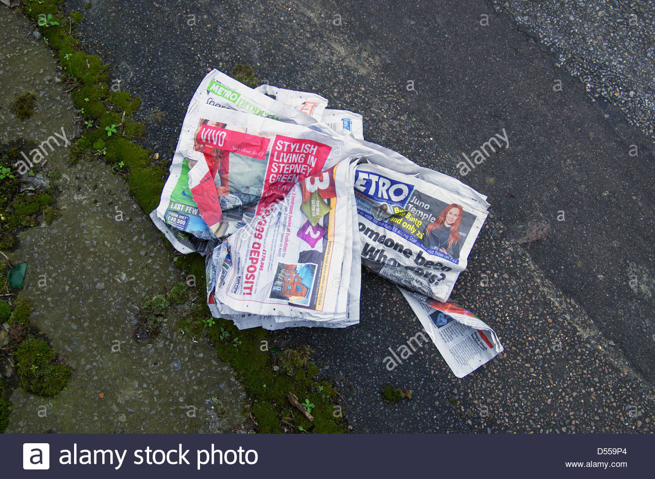 Free tabloid newspaper abandoned in street, London - Stock Image