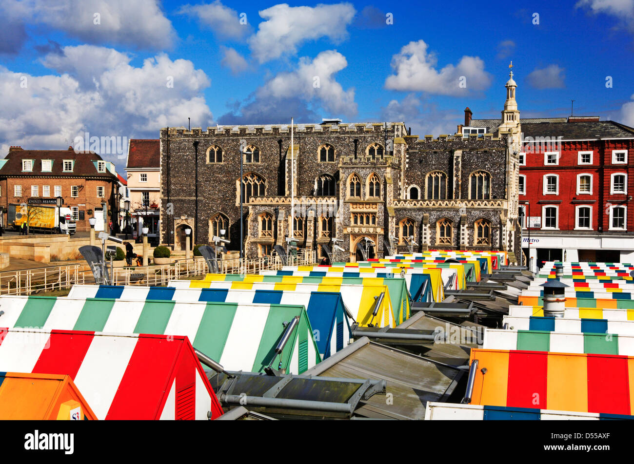 A view of the Guildhall over colourful market stall roofs in the centre of Norwich, Norfolk, England, United Kingdom. - Stock Image