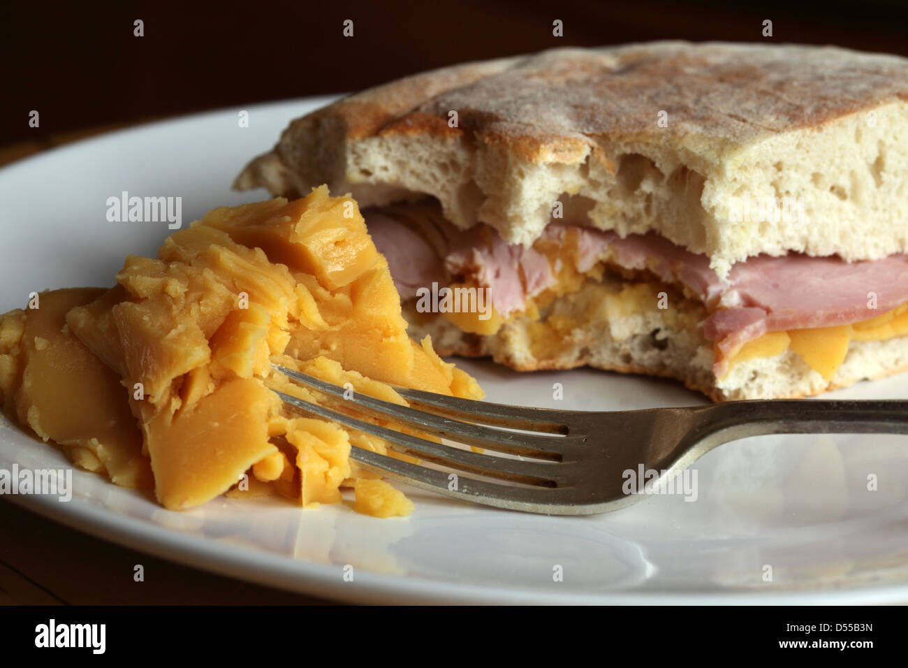 A pease pudding and ham sandwich is served in stottie cake and a side serving of pease pudding. - Stock Image