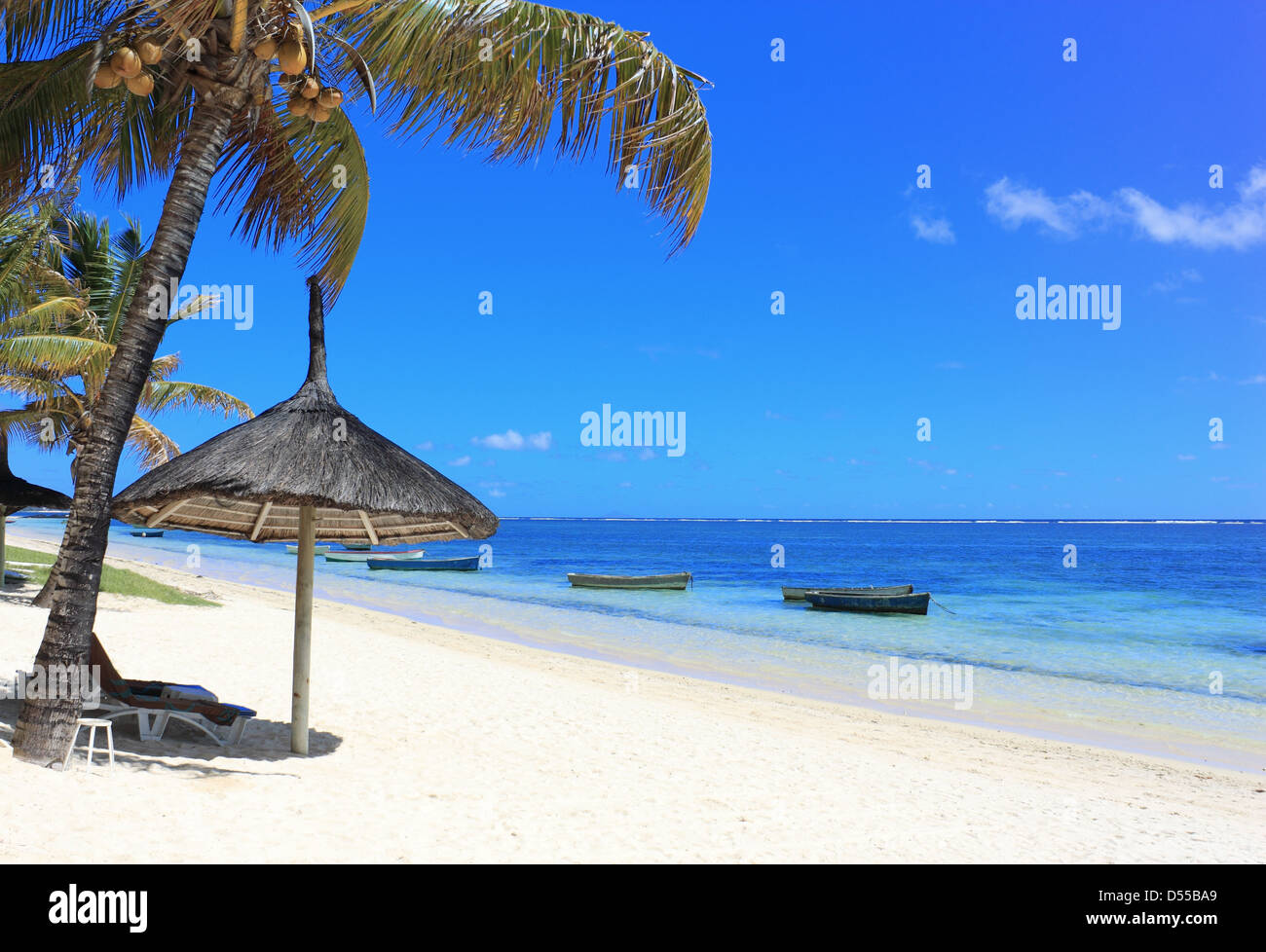 Palm beach with boat on the ocean in Mauritius island - Stock Image