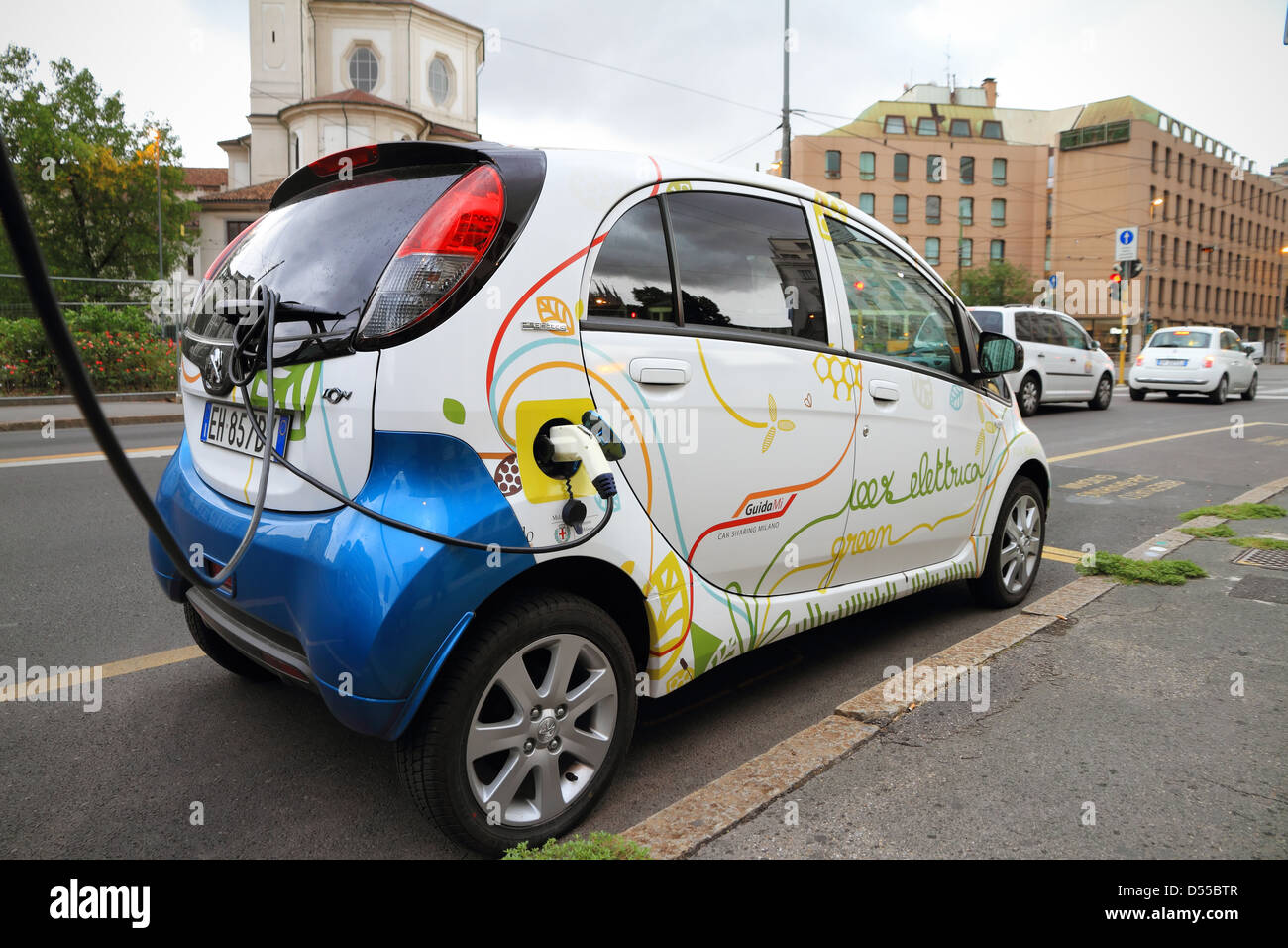 Milan: Electric vehicle in car sharing station charging the battery - Stock Image