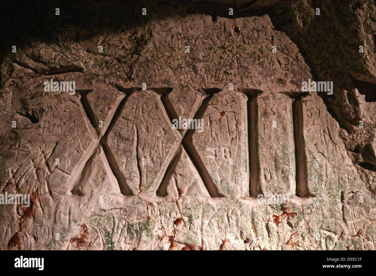 Carving in the Hell Fire Caves in West Wycombe Buckinghamshire - Stock Image