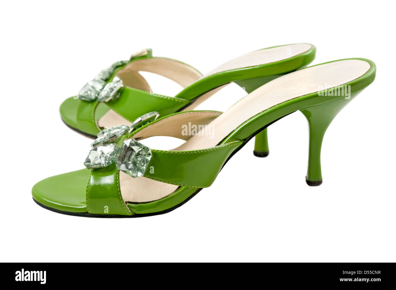 The green shoes are photographed on the white background - Stock Image