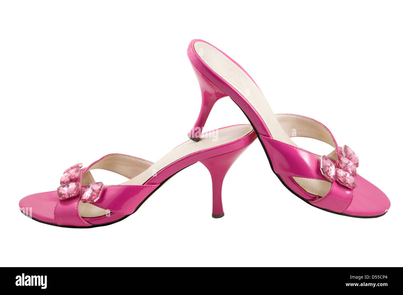 The two pink shoes are photographed on the white background - Stock Image