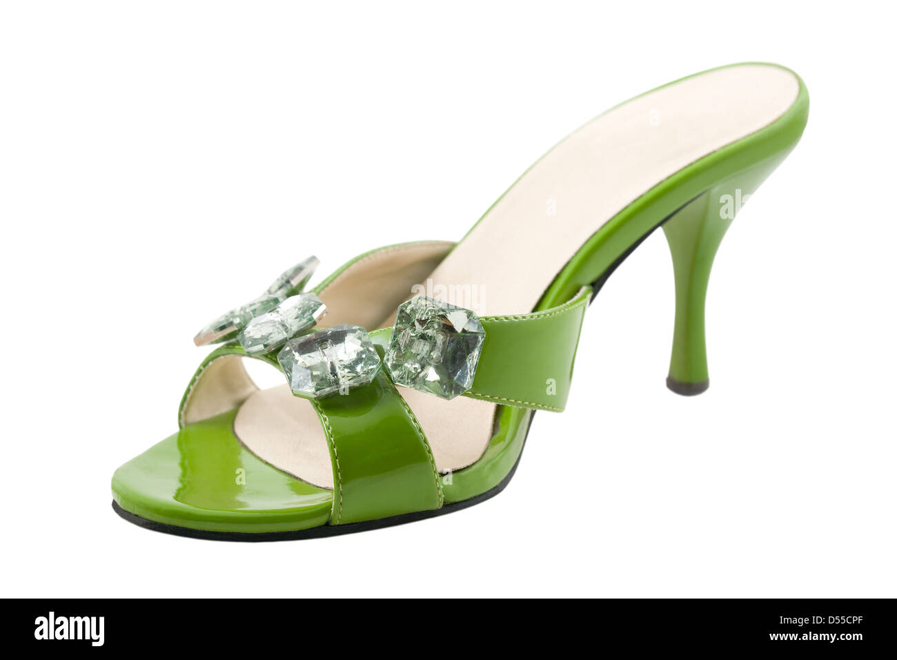 The green shoe are photographed on the white background - Stock Image