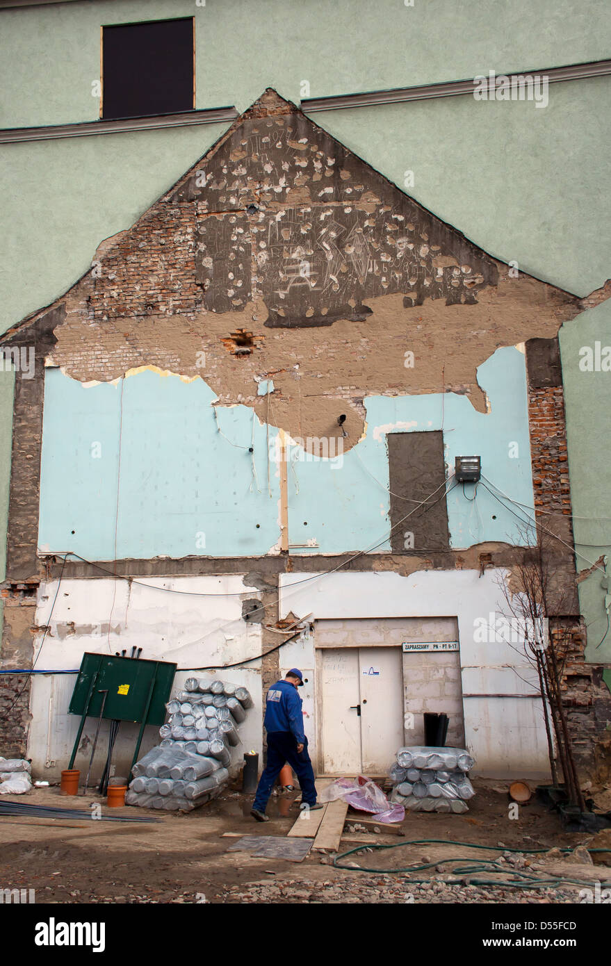 Poznan, Poland, outlines of a demolished house on the side of a building - Stock Image