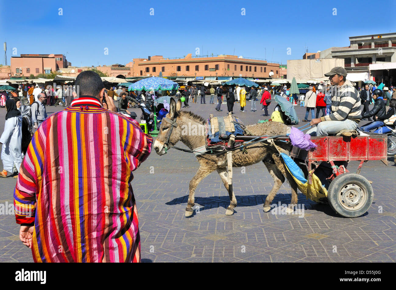 Typical of the daily hubbub of traders and tourists crowds in Jemaa el- Fnaa ( Square) . Marrakesh, Morocco Stock Photo