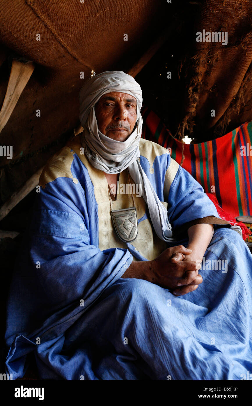 A nomad, Sahrawi man, in his tent. - Stock Image