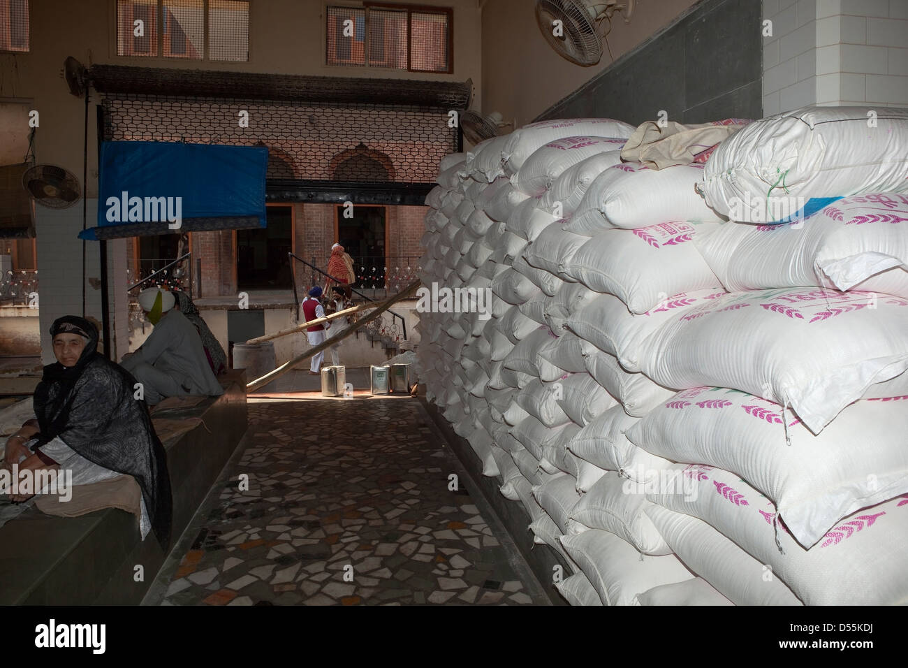 A stack of atta flour in sacks at the free kitchen inside the Golden Temple complex at Amritsar Punjab India - Stock Image