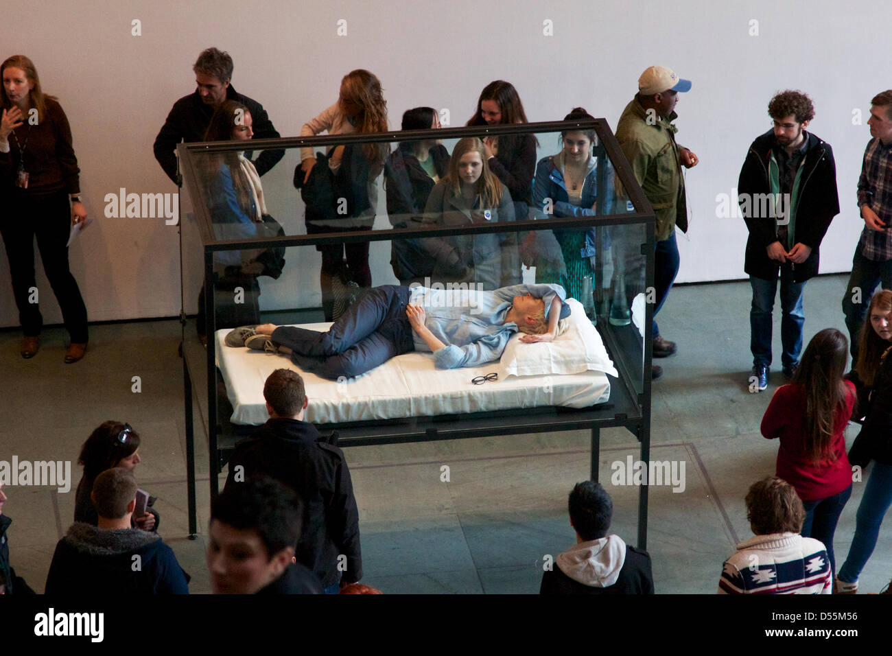 New York, NY, USA. 23rd March, 2013. Visitors at the Museum of Modern Art (MoMA) watch as Hollywood star Tilda Swinton - Stock Image