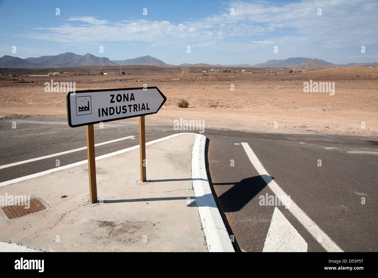 Gran Tarajal, Spain, a sign to an industrial area leads into the void - Stock Image