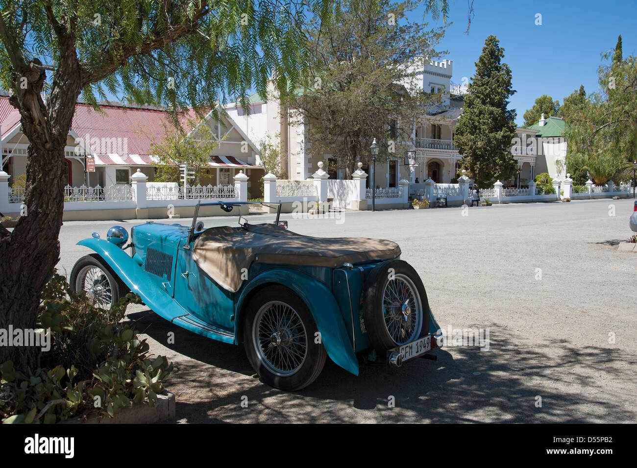 Old MG convertible car parked in the shade outside the Lord Milner ...