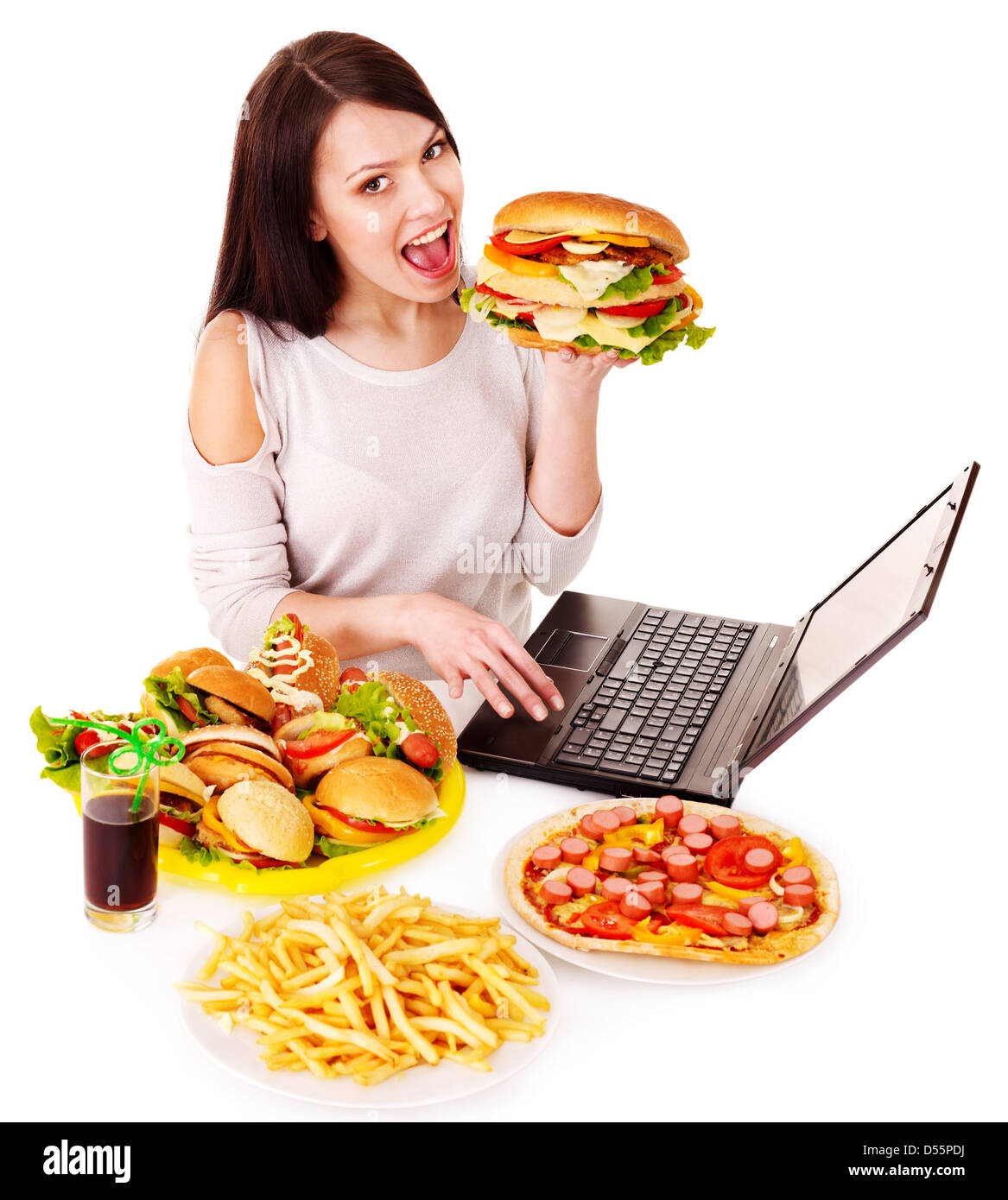 Woman eating fast food at work. Isolated. - Stock Image
