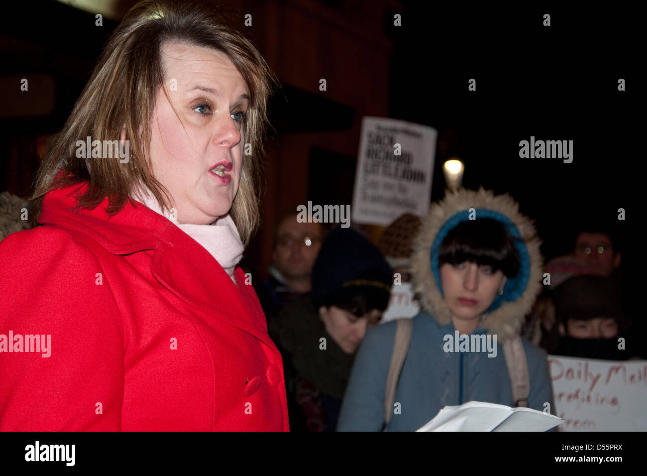 London, UK. 25th March, 2013.   A woman speaks at a candle-lit vigil held in memory of deceased schoolteacher Lucy - Stock Image