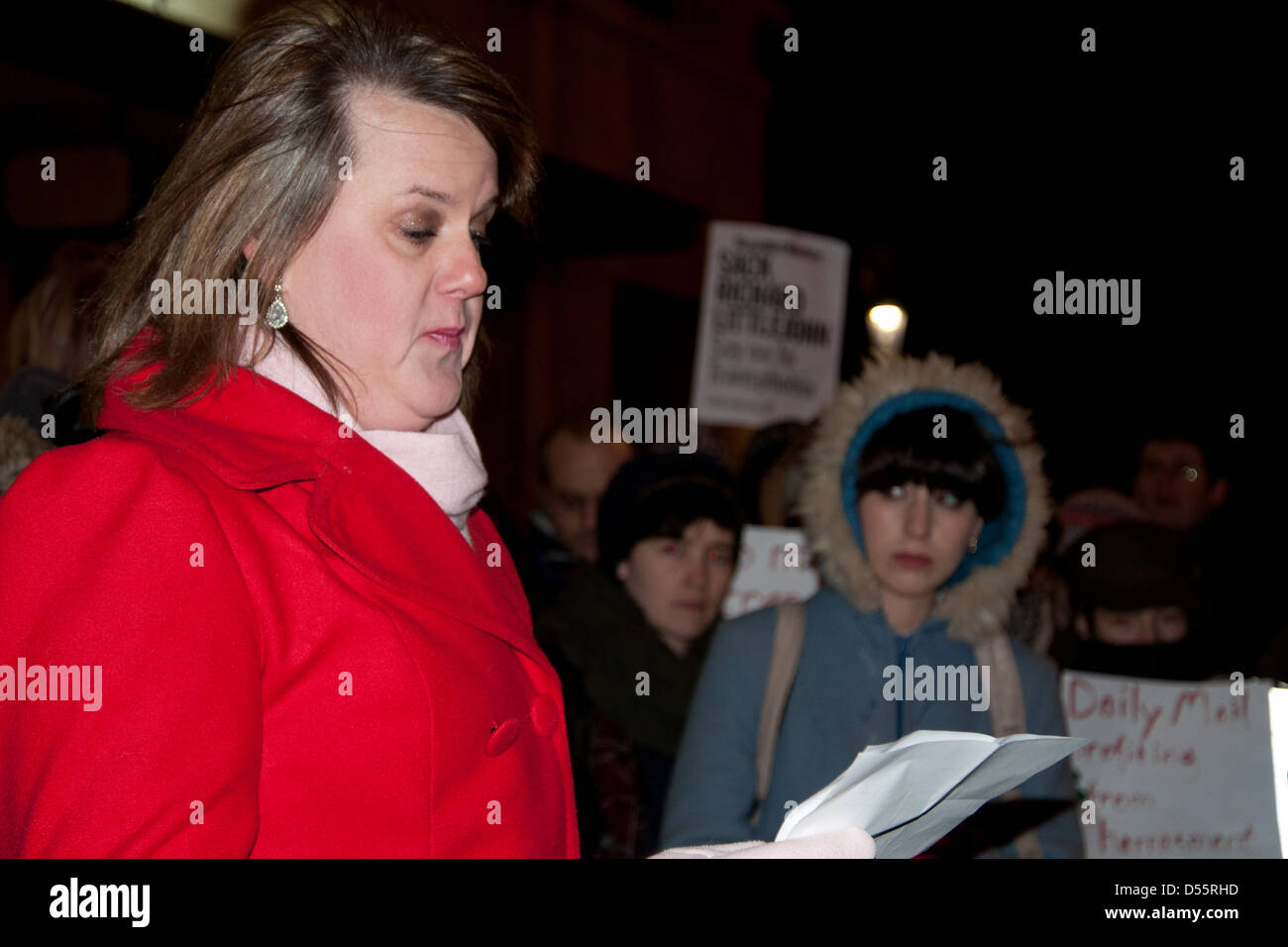 London, UK. 25th March, 2013.   A speaker addresses the crowd at a candle-lit vigil in memory of deceased schoolteacher - Stock Image