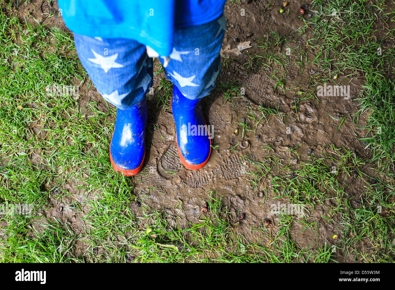 Child Wearing Blue Welly Boots Stock Photo