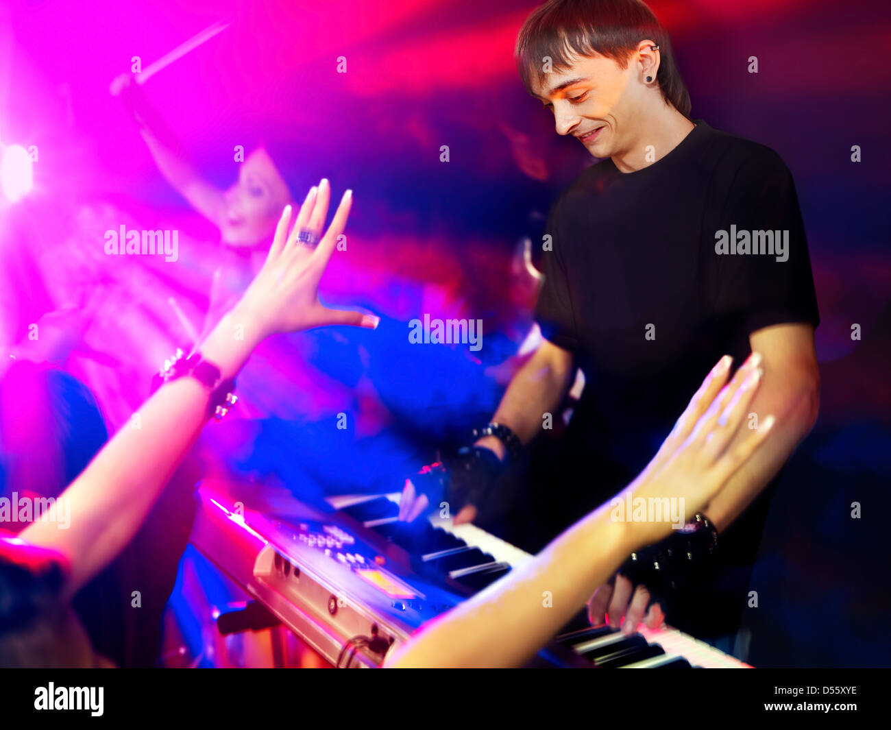 Musical group performance in night club. - Stock Image