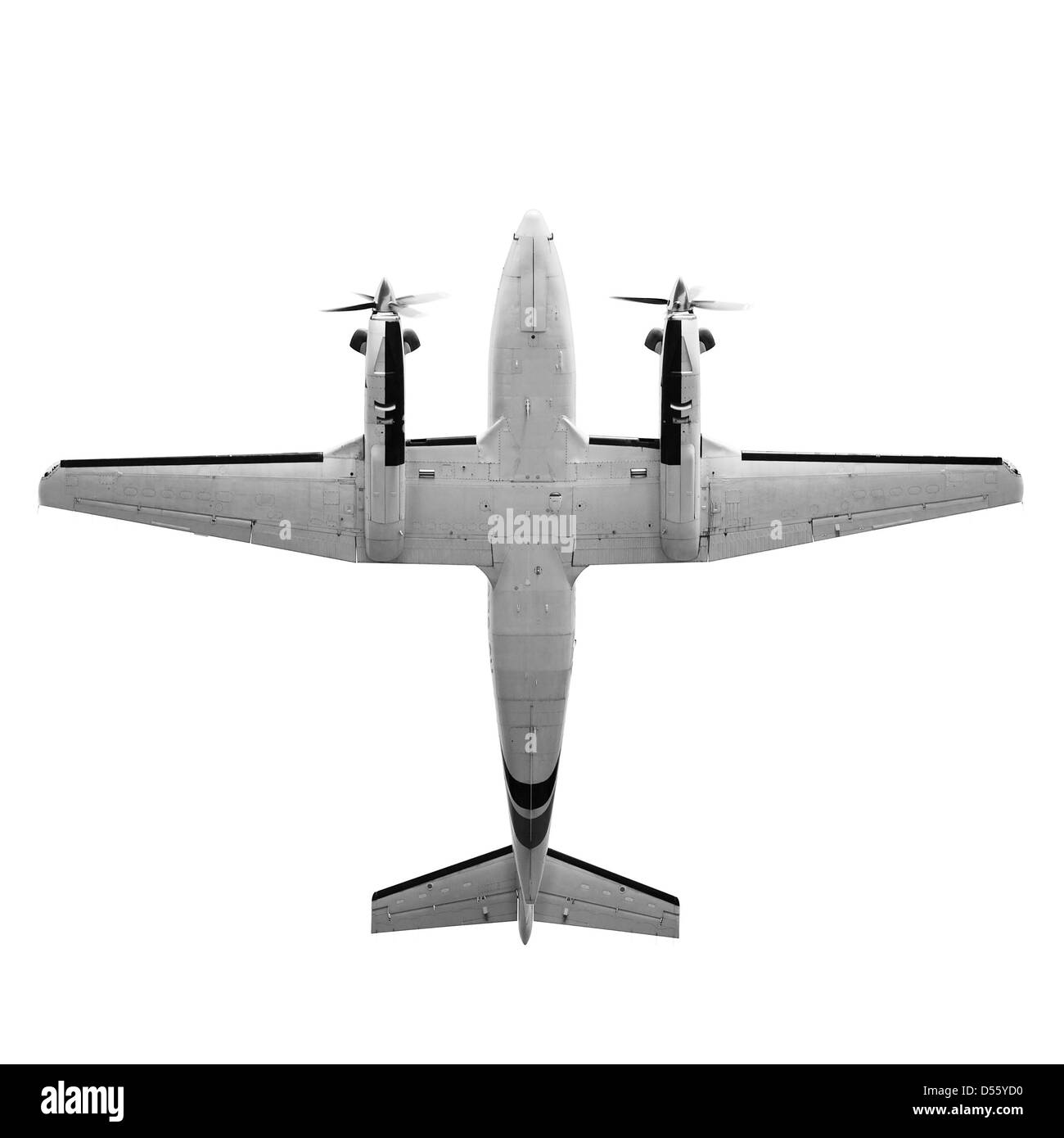 Old twin prop gray cargo plane isolated on white background. Bottom view - Stock Image
