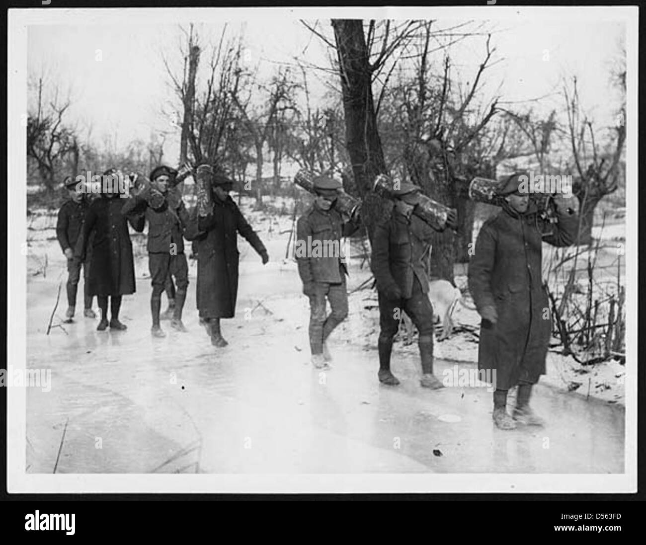 Gunners bringing charges up to their guns across the ice - Stock Image
