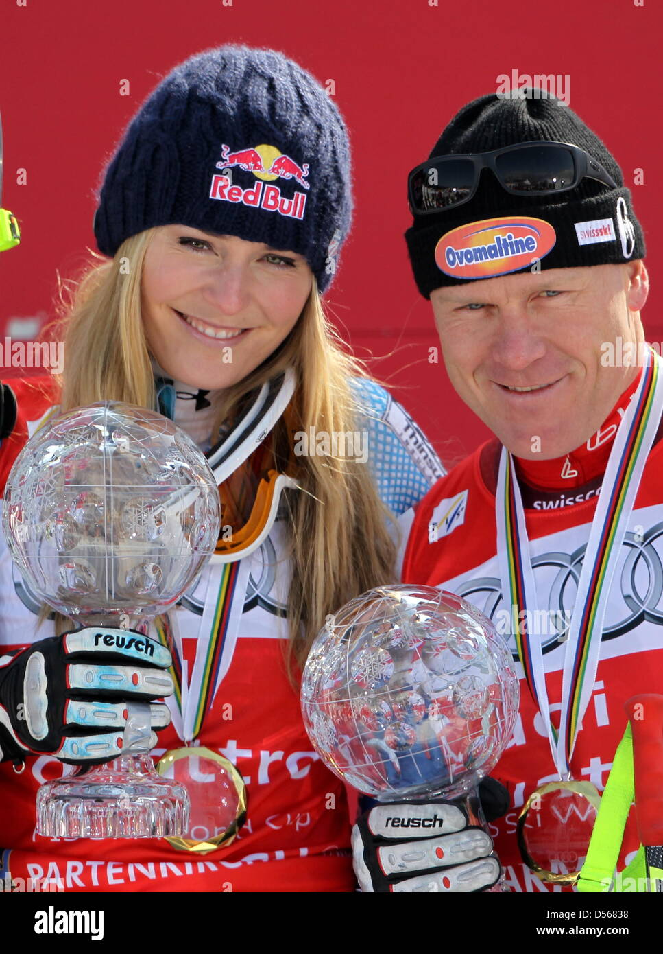 US Lindsey Vonn (L) and Swiss Didier Cuche celebrate with their trophies for their overall downhill victories at - Stock Image