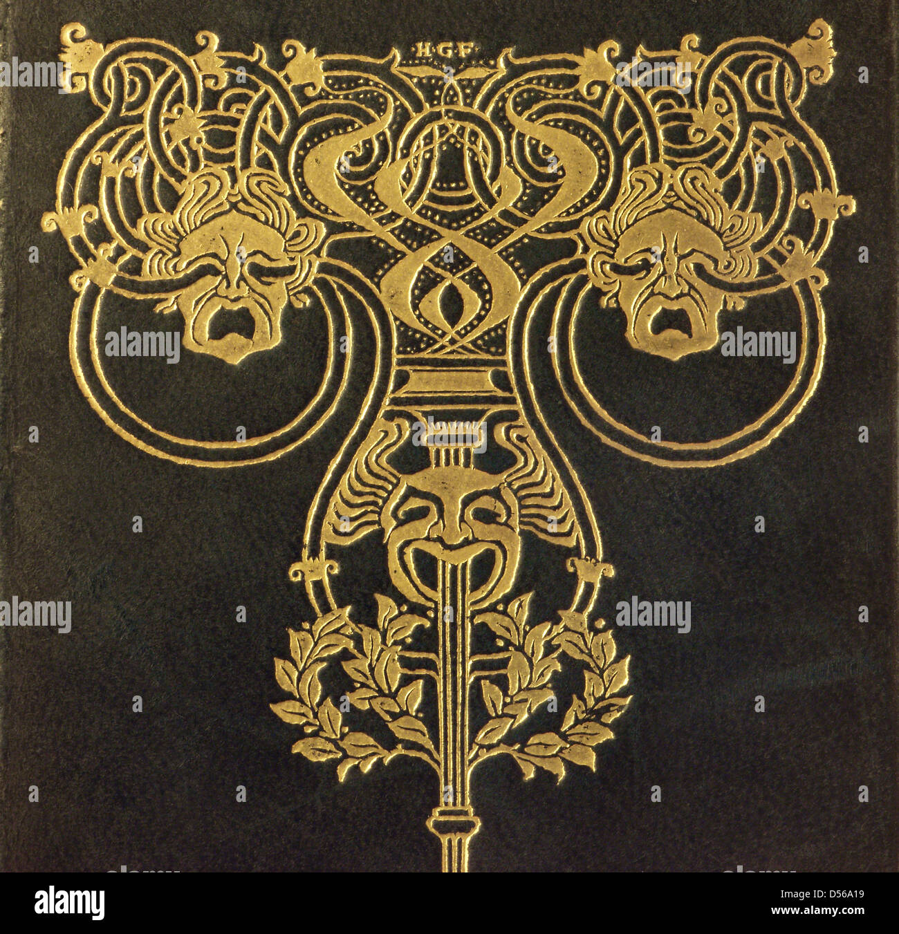 A section of the front cover of an antiquarian gold tooled leather bound volume of Shakespeares plays - Stock Image