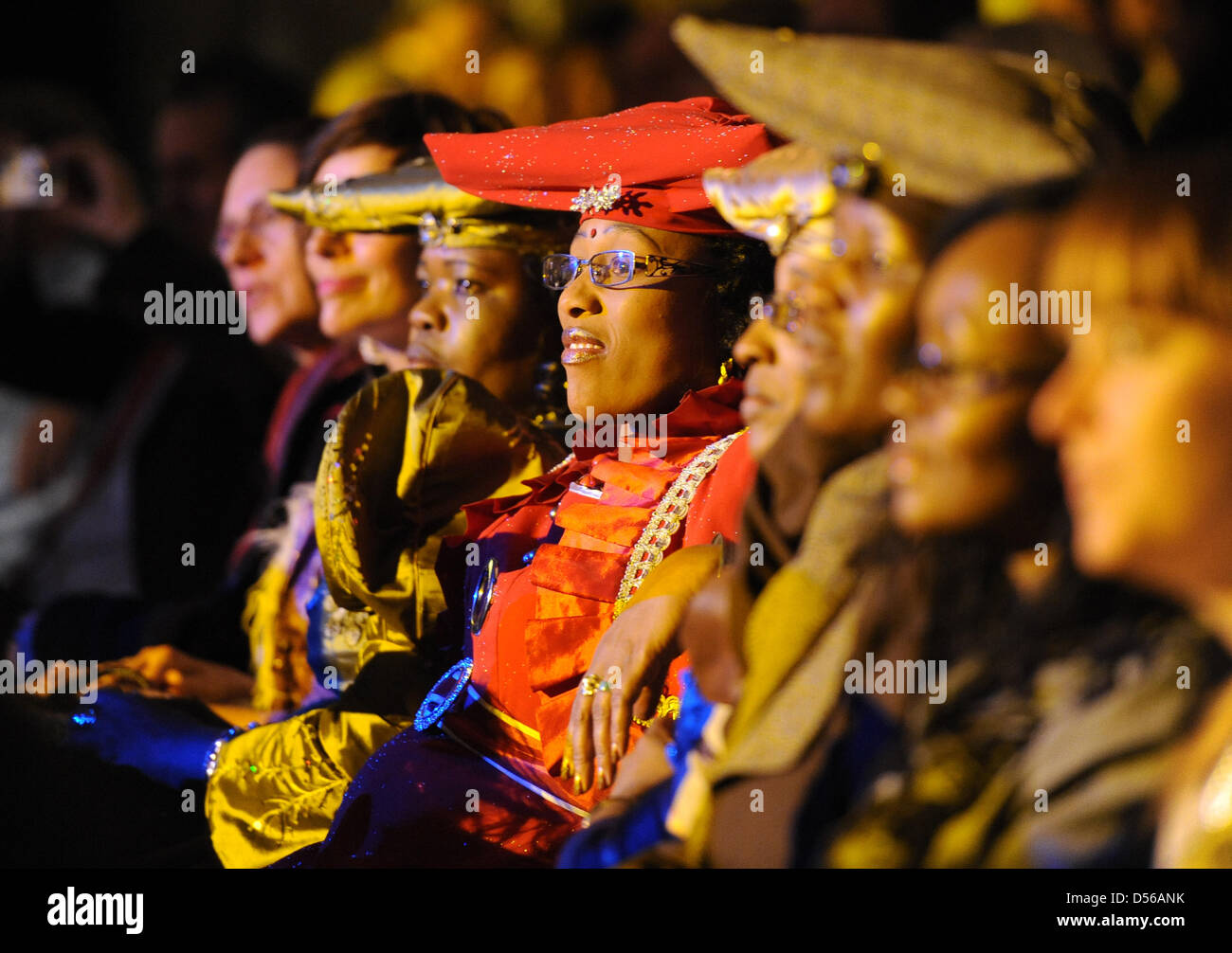 Women wearing the traditional dress of Herero people attend a fashion show in Berlin, Germany, 10 November 2010. Stock Photo